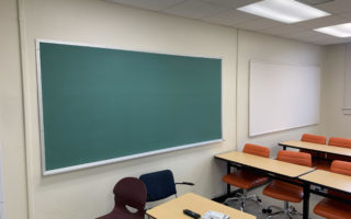 Picture of Architecture Annex Classroom 02 angle with view of green chalkboard